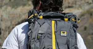 Backpacker wearing hiking pack