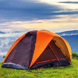 Orange tent and a blue sky